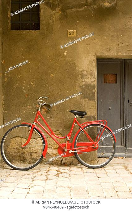 Red bicycle. Pienza. Italy