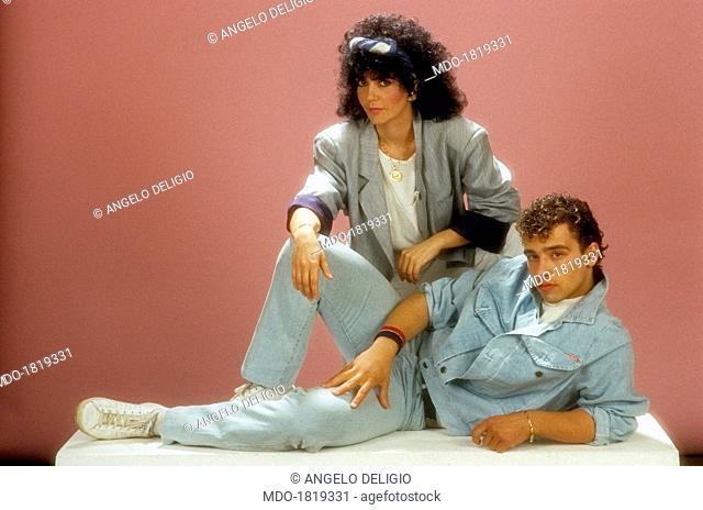 Italian singer-songwriter Eros Ramazzotti posing with Italian singer Fiordaliso (Marina Fiordaliso). Italy, 1984