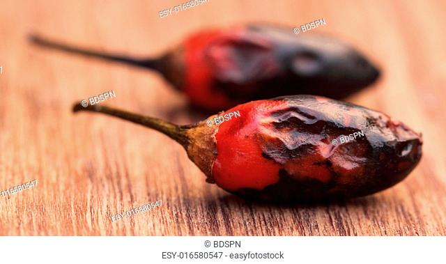Red hot chili close up on wooden surface