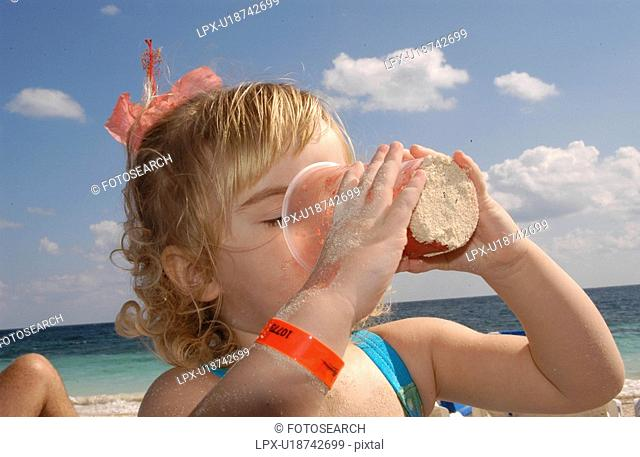 Girl Drinking out of a Cup