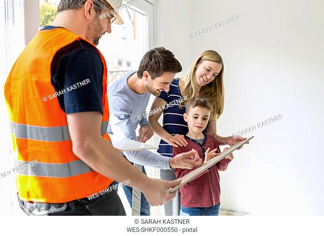 Construction worker showing family tile samples
