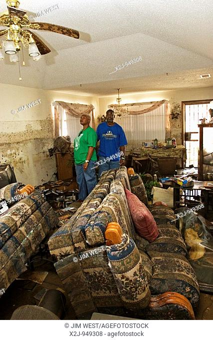 New Orleans, Louisiana - September 18, 2005 - Michele Baker and her husband Alexander inspect the Hurricane Katrina devastation of their home in east New...
