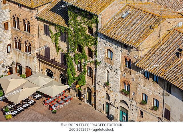 Piazza della Cisterna from above in San Gimignano, Tuscany, Italy