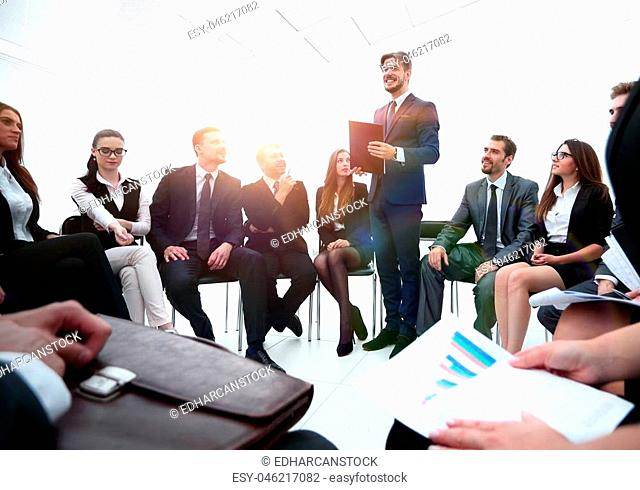 business coach communicate with the business team. the concept of team building