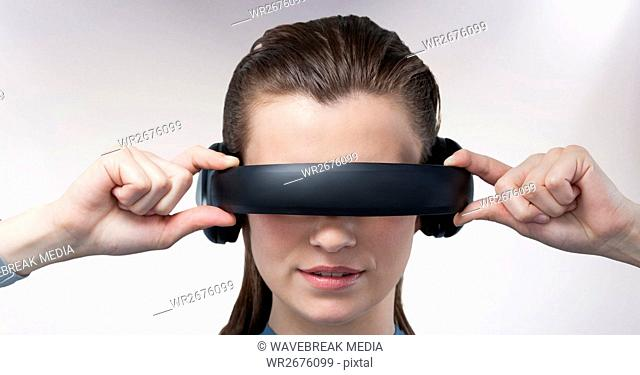 Close-up of woman using virtual reality headset