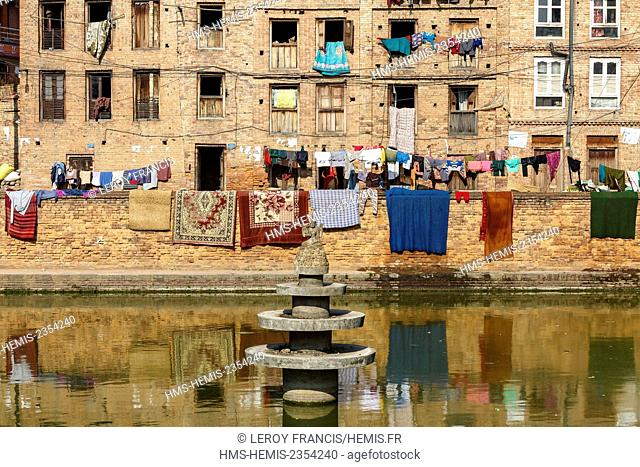 Nepal, Bagmati zone, Bhaktapur, listed as World Heritage by UNESCO, pond and brick houses