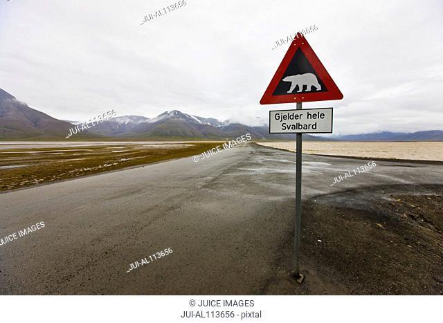 Polar bear warning road sign near Longyearbyen, Spitsbergen, Svalbard, Norway, Europe