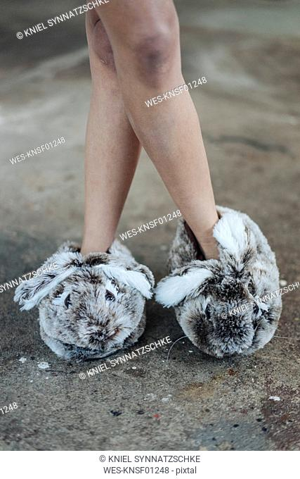 Woman wearing cute fluffy slippers