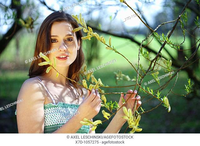 Portrait of young brunette woman holding brace pollen allergy tree willow pollen pollination nose