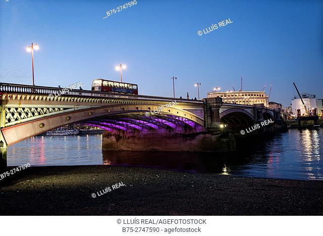Bus crossing Blackfriars Bridge by night. London, England