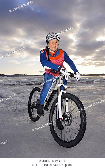 Smiling mid adult woman on mountain bike