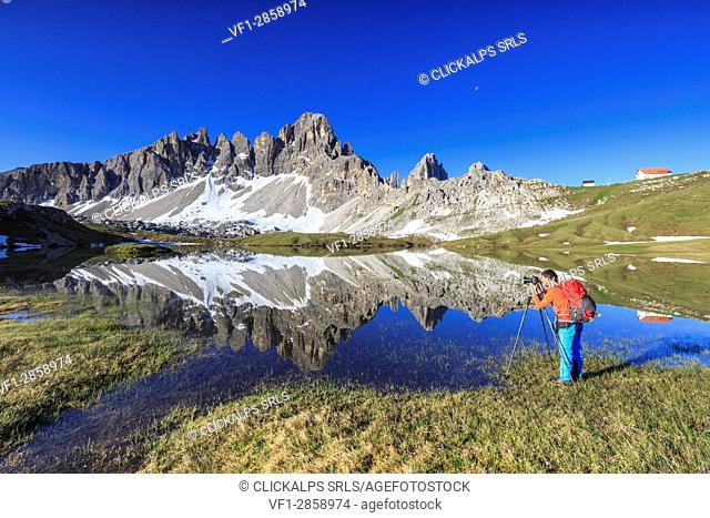 The photographer captures the Mount Paterno reflected in the lake. Sesto Dolomites Trentino Alto Adige Italy Europe