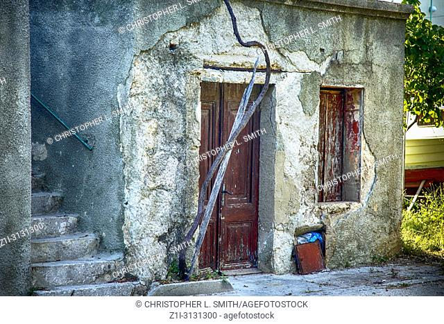 Old building needing repair on the edge of the small viiage of Punat on the Croatian island of Krk