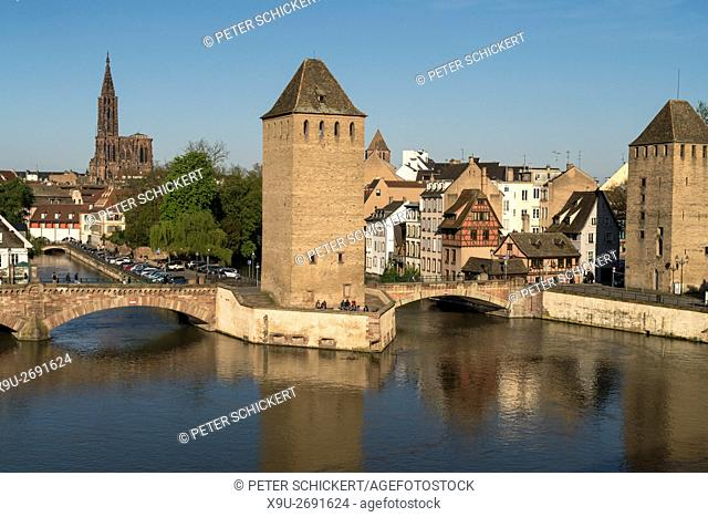 towers of the medieval bridge Ponts Couverts, Ill river and cathedral in Strasbourg, Alsace, France