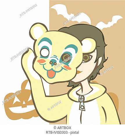 Girl holding a face mask