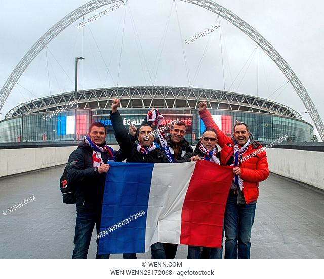 First French fans arrive at Wembley Stadium ahead of tonights match. The stadium is lit up with French Tricolour flags and the message 'Libertè, Ègalitè