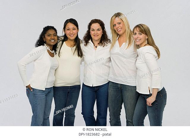 Group of women wearing matching outfits