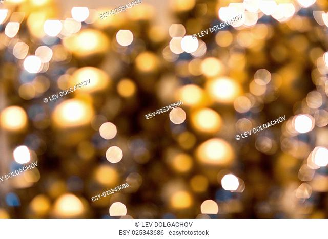 holidays, luxury and background concept - blurred golden christmas lights bokeh