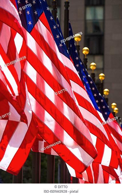 Row of American flags, close-up, New York, USA