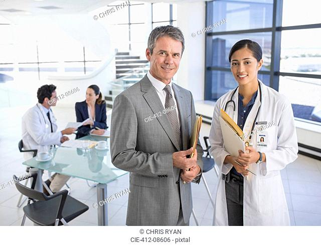 Portrait of smiling businessman and doctor in meeting