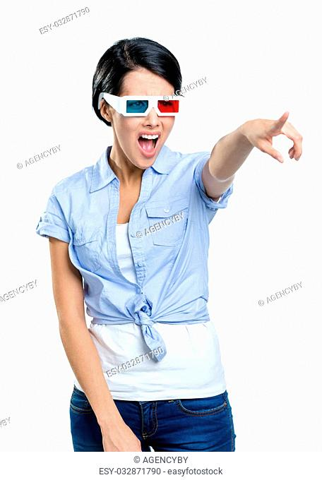 Pointing with hand pretty girl in 3D glasses, isolated on white. Expression of disgust