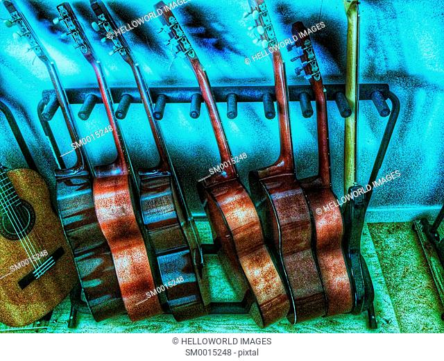 Rack of wooden acoustic guitars