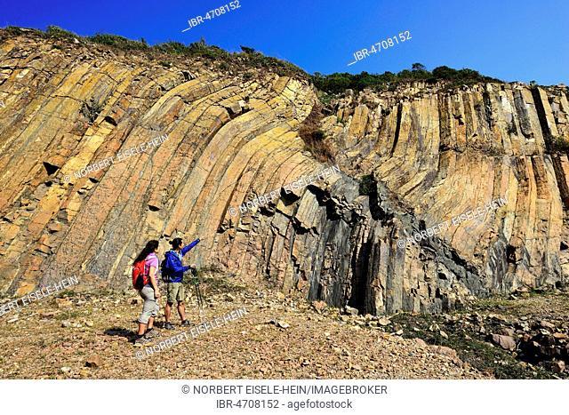 Hikers in front of Hexagonal Rock Columns in Geo Park, Sai Kung Peninsula, New Territories, Hong Kong, China