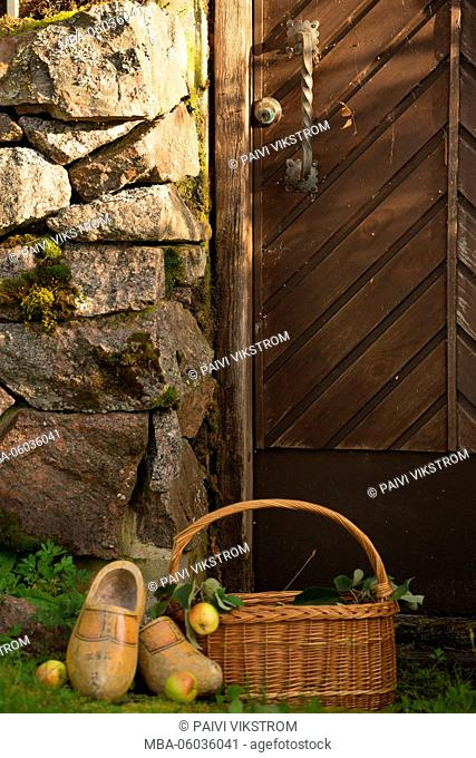 Apple basket and clogs front of the root celler