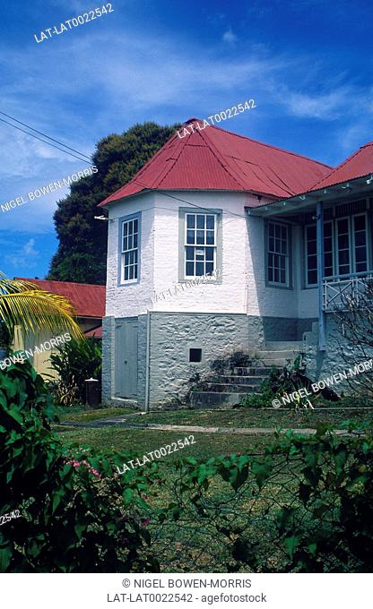 Traditional architecture. Building. House. Gardens. Trees. Tin roof