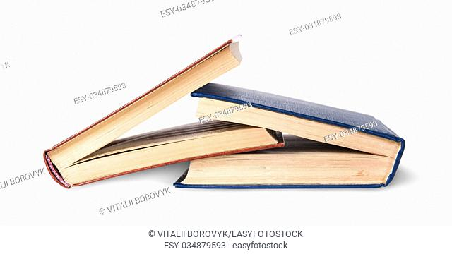 Two old books imbedded in one another isolated on white background