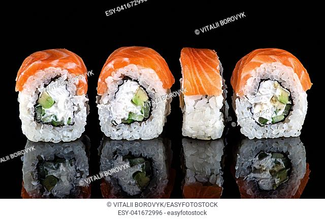 Traditional Japanese Sushi roll Philadelphia. Black background with reflection