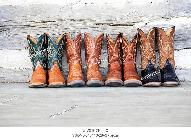 b1c4800087a Row of cowboy boots Stock Photos and Images | age fotostock