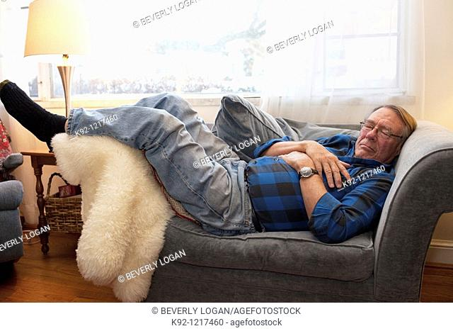 Senior man sleeping on a chair