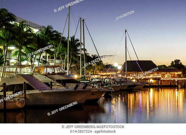 Florida, Key Largo, Upper Florida Keys, Courtyard Key Largo, waterfront, canal, marina, sailboat, yacht, dock, boat, slip, palm tree, twilight, night