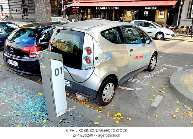 Paris, France. Electric car being recharged in the street