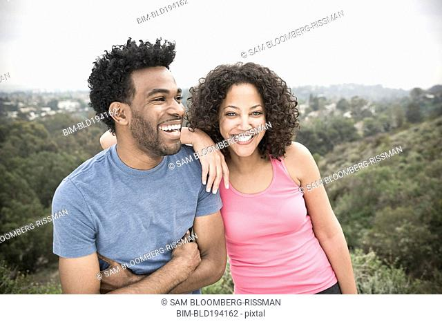 African American man and his girlfriend in remote area