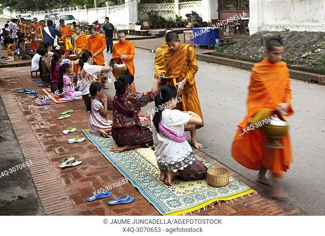 Every day very early in the morning, hundreds of monks walk the streets to beg