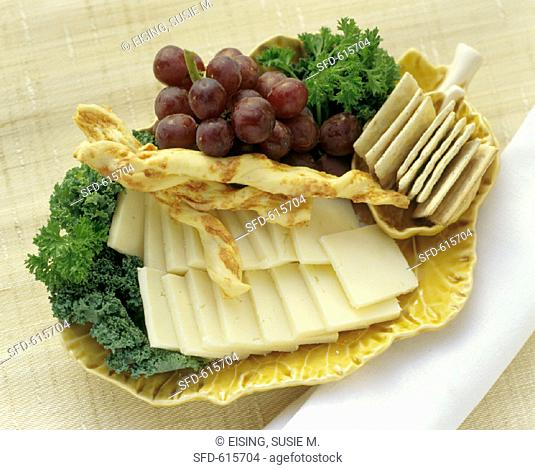 Cheese Crackers Cheese Sticks and Grapes Platter