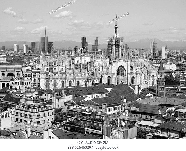 Aerial view of Duomo di Milano gothic cathedral church in Milan, Italy in black and white