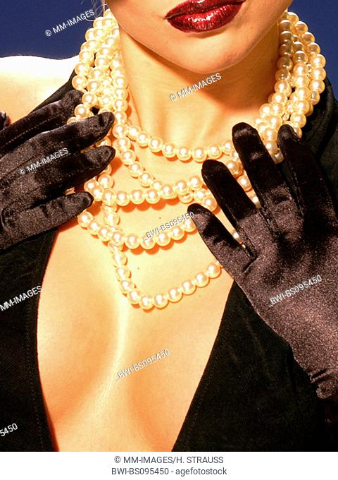 , woman fashionable wearing pearls