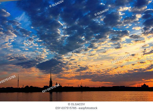 Bright sunrise over the Neva River, the view of Peter and Paul Fortress, St. Petersburg, Russia