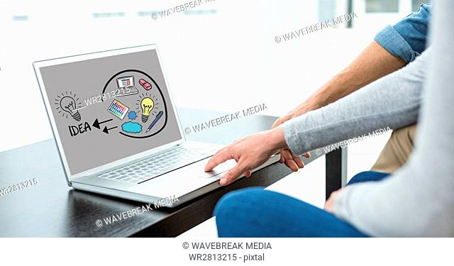 Digital composite image of business people using laptop with idea icons on screen