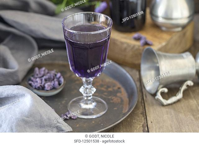 A glass of champagne with violet syrup from Toulouse