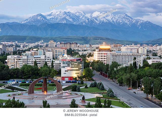 Scenic view of cityscape and mountains