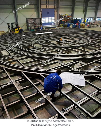 An employee of the stagecraft company SBSBuehnentechnik GmbH works on a revolving stage for a theatre in Surgut, Russia, at the factory grounds inDresden