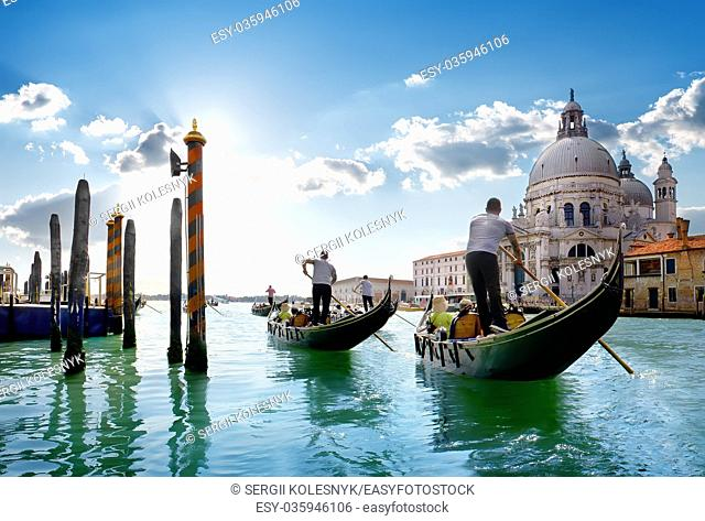 Ride on gondolas along the Gand Canal in Venice, Italy