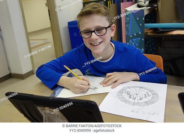 6th Grade Boy Drawing in Art Class, Wellsville, New York, USA