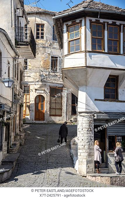 Passing the time of day on the main street in the bazaar area of Gjirokastra in southern Albania