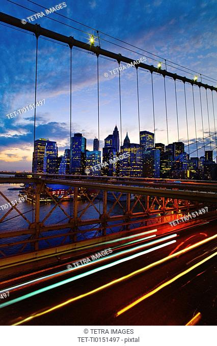 USA, New York State, New York City, Lower Manhattan and Brooklyn Bridge at dusk