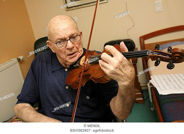 HOME FOR THE AGED Photo essay in a nursing home for the elderly in the department of Aisne, France. Retired man playing violon